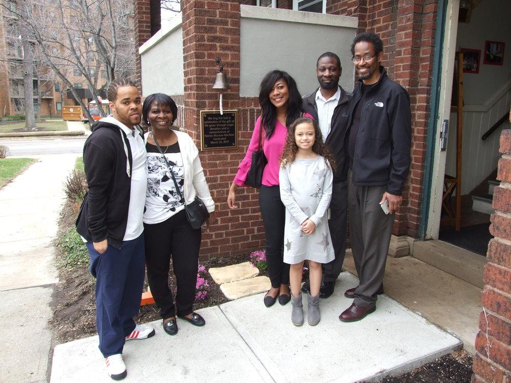 Family outside transplant house